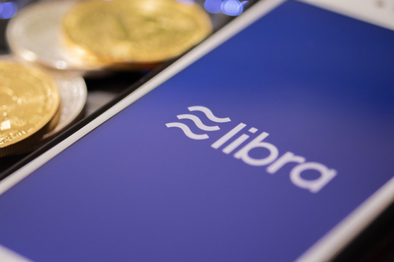 Libra Facebook cryptocurrency and bitcoin cryptocurrency, Libra coins concept.