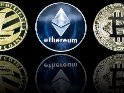 cc Alpari Org, Flickr, modified, An image of some of the most popular cryptocurrencies. This photo shows a Litecoin coin, Ethereum coin and Bitcoin coin standing vertically with reflections underneath them on a black background. This image is released under Creative Commons and is therefore available for reuse. We do request that you credit us with a link to www.alpari.org if you do use this image.